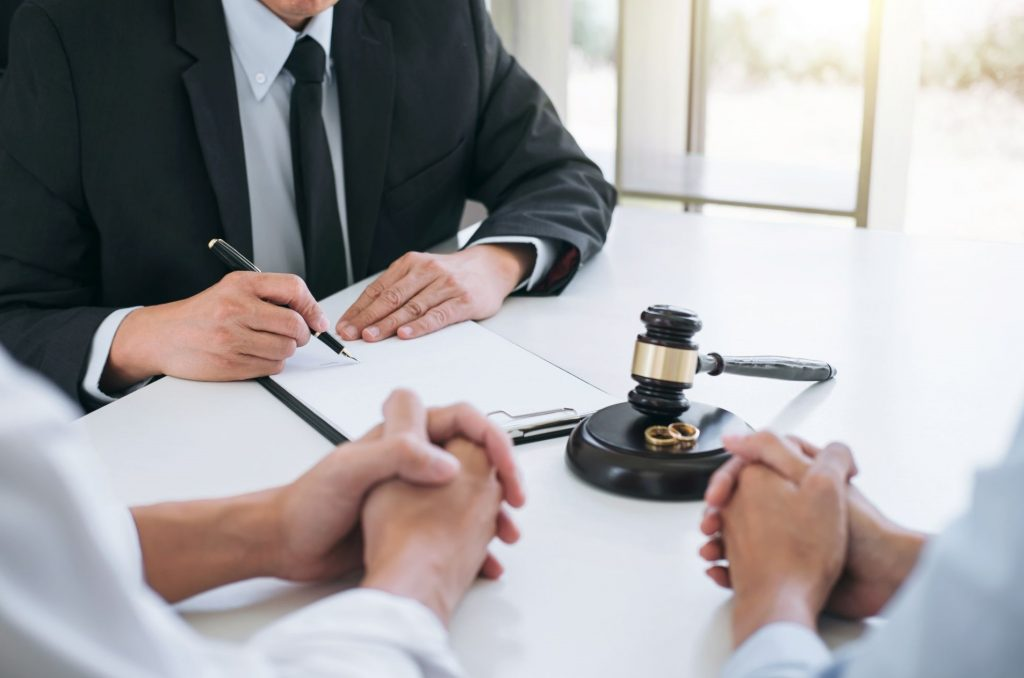 a couple speaking with a divorce lawyer