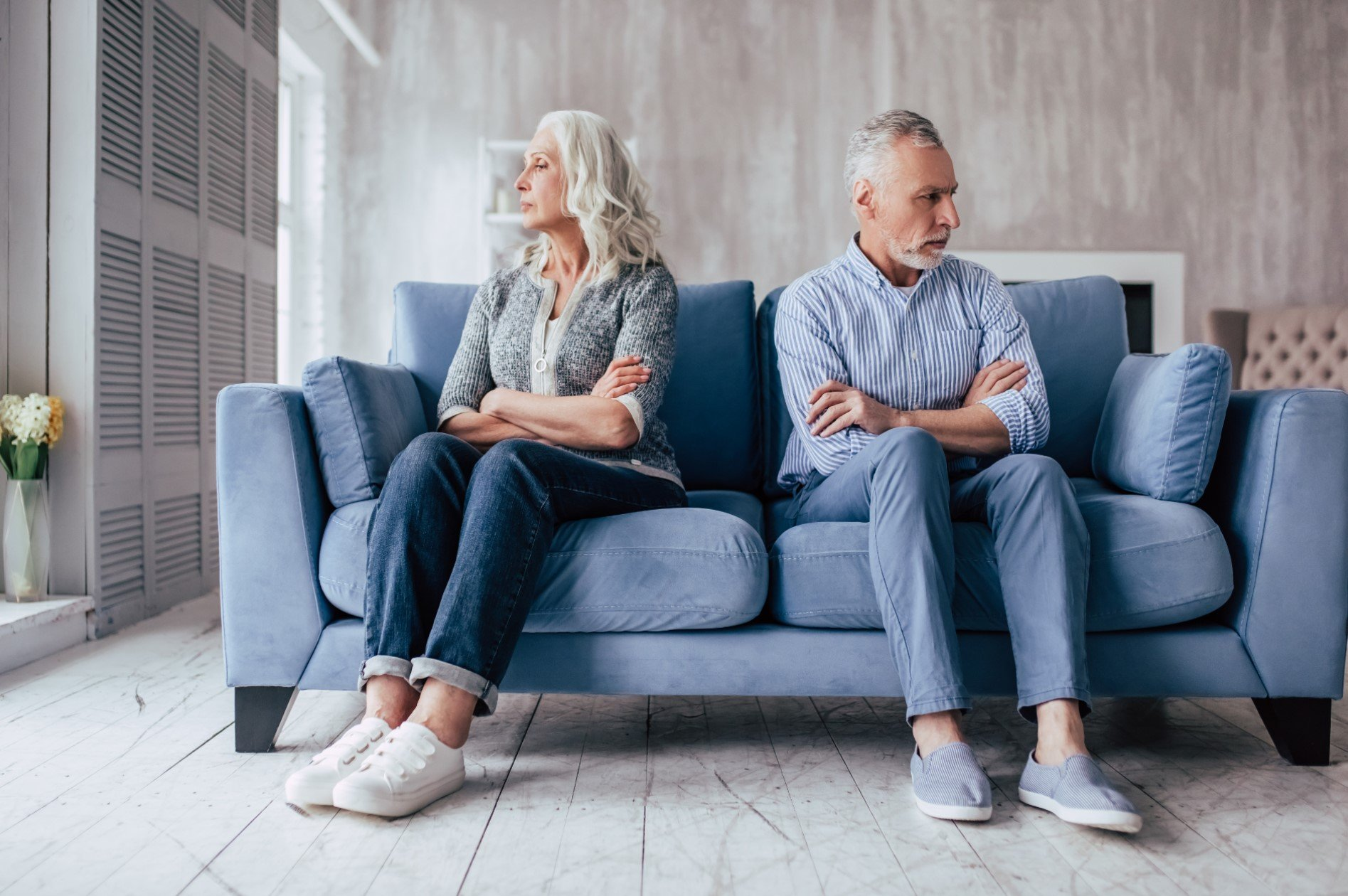 a couple sit facing opposite directions after divorce