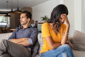 Young married couple sit in a Toronto apartment after deciding to get divorced